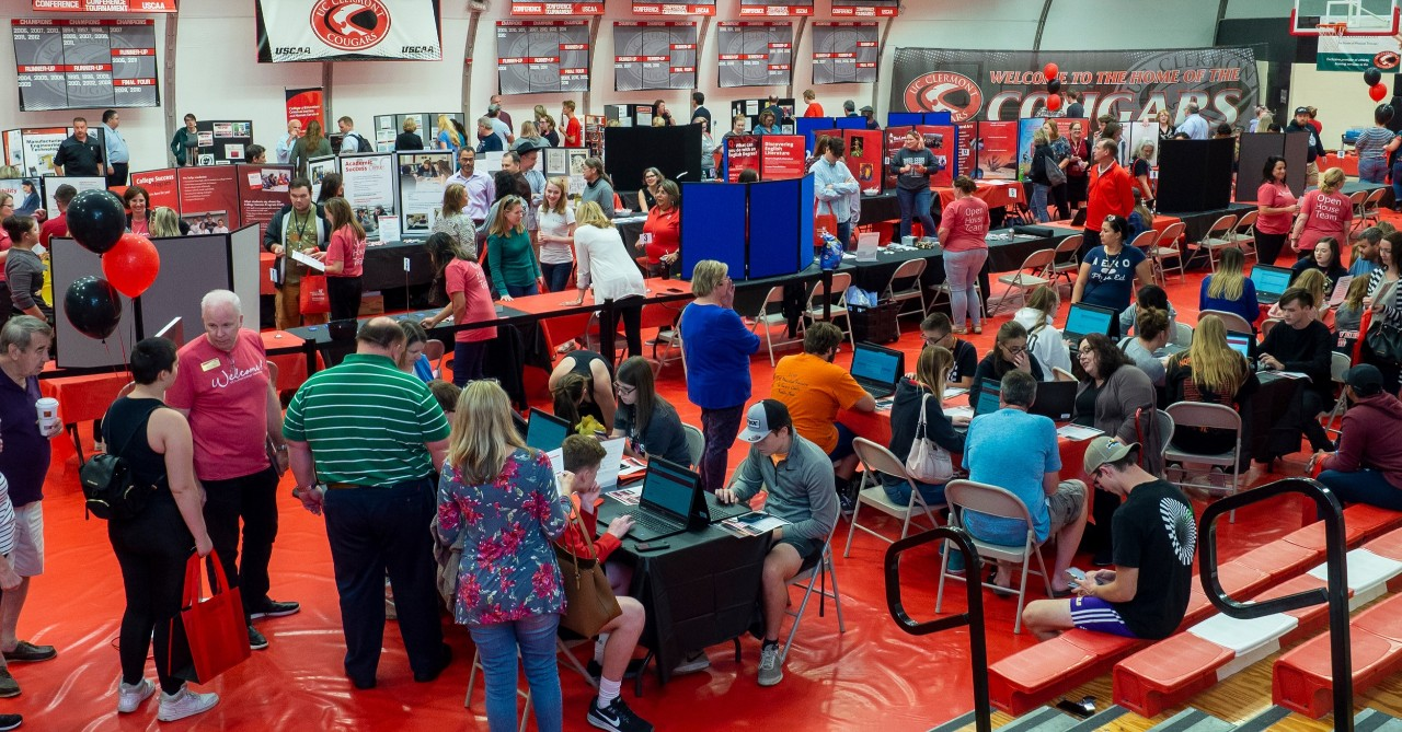 Students, parents, faculty and staff attend a UC open house.