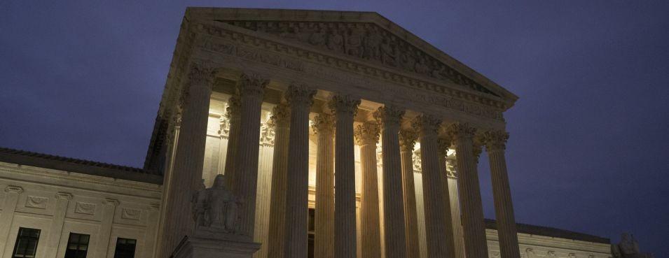 u.s. supreme court building at night