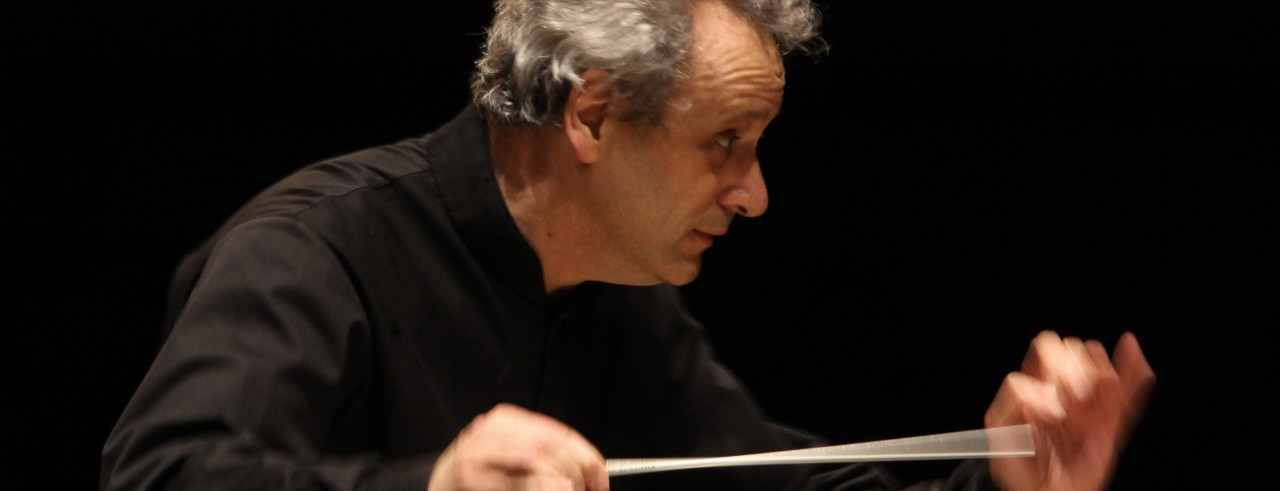 Conductor Louis Langrée leading an orchestra