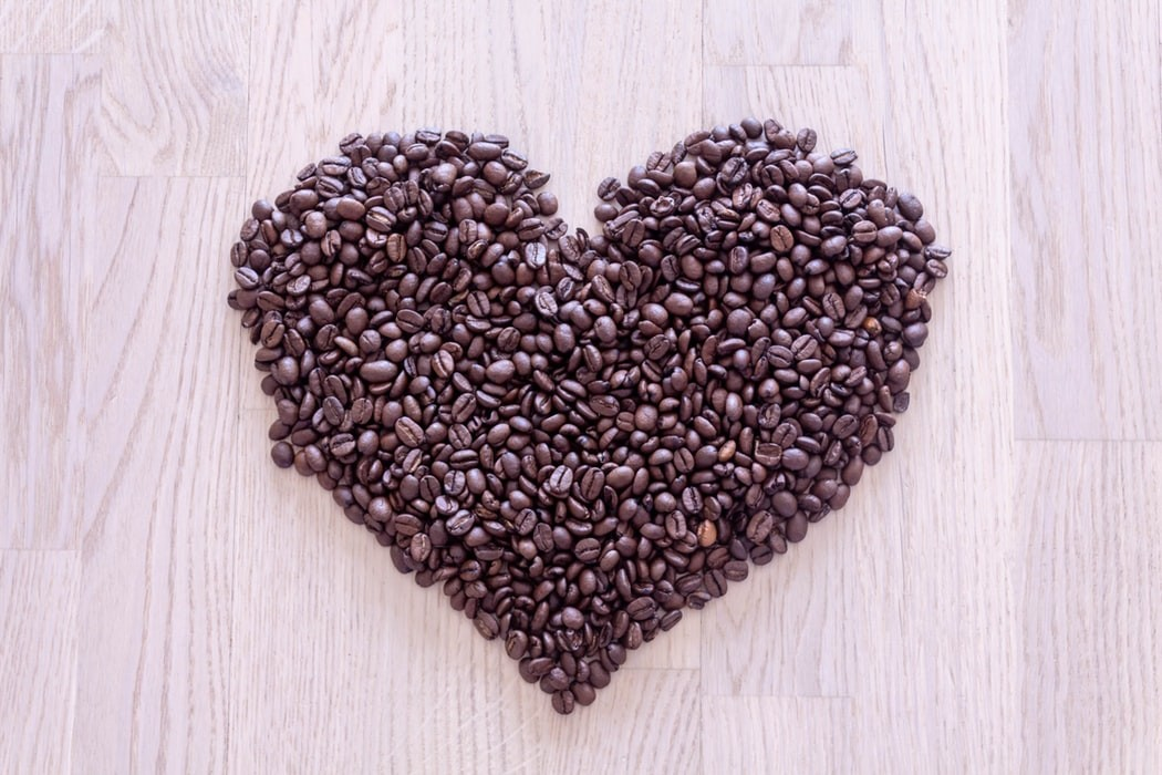 photo of coffee bean arranged in shape of a heart