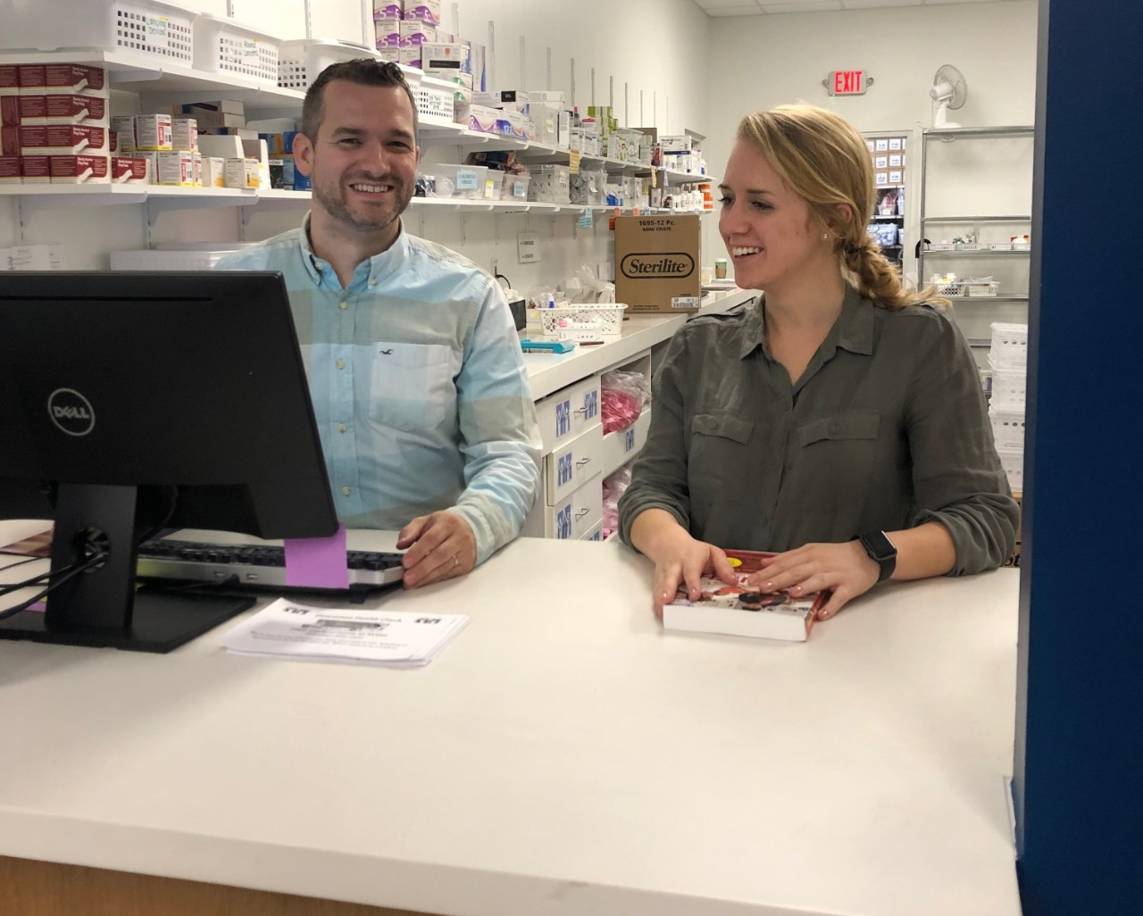 Katherine Pastor, a fourth-year nursing major, converses with St. Vincent De Paul's Pharmacist.