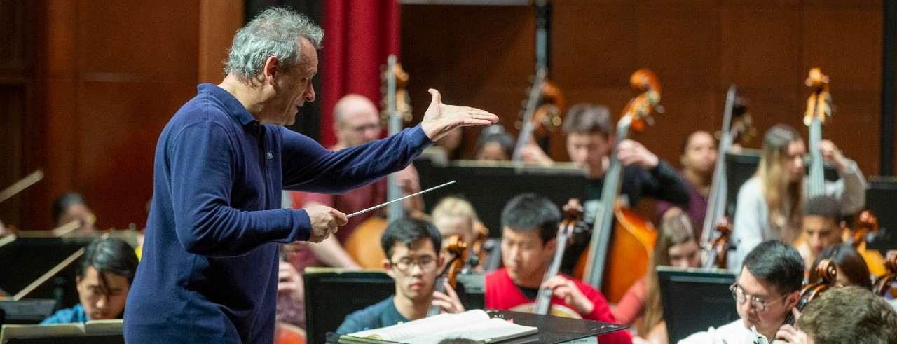 Louis Langree conducts a student orchestra in a rehearsal