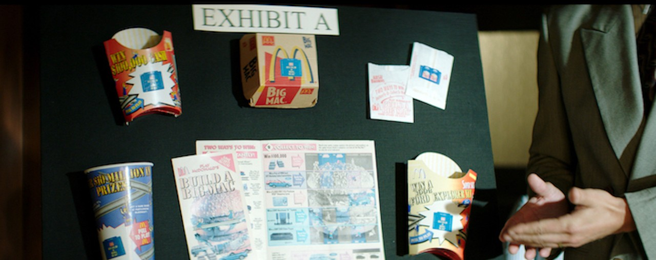 McDonald's monopoly pieces displayed on an evidence board