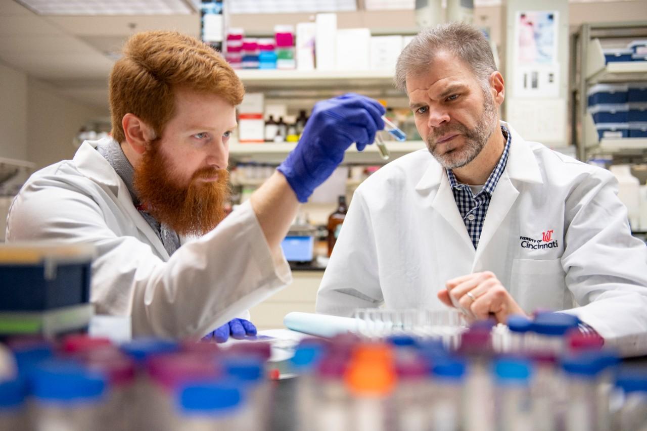 Mark Castleberry and Sean Davidson, PhD,  shown in a UC College of Medicine laboratory.