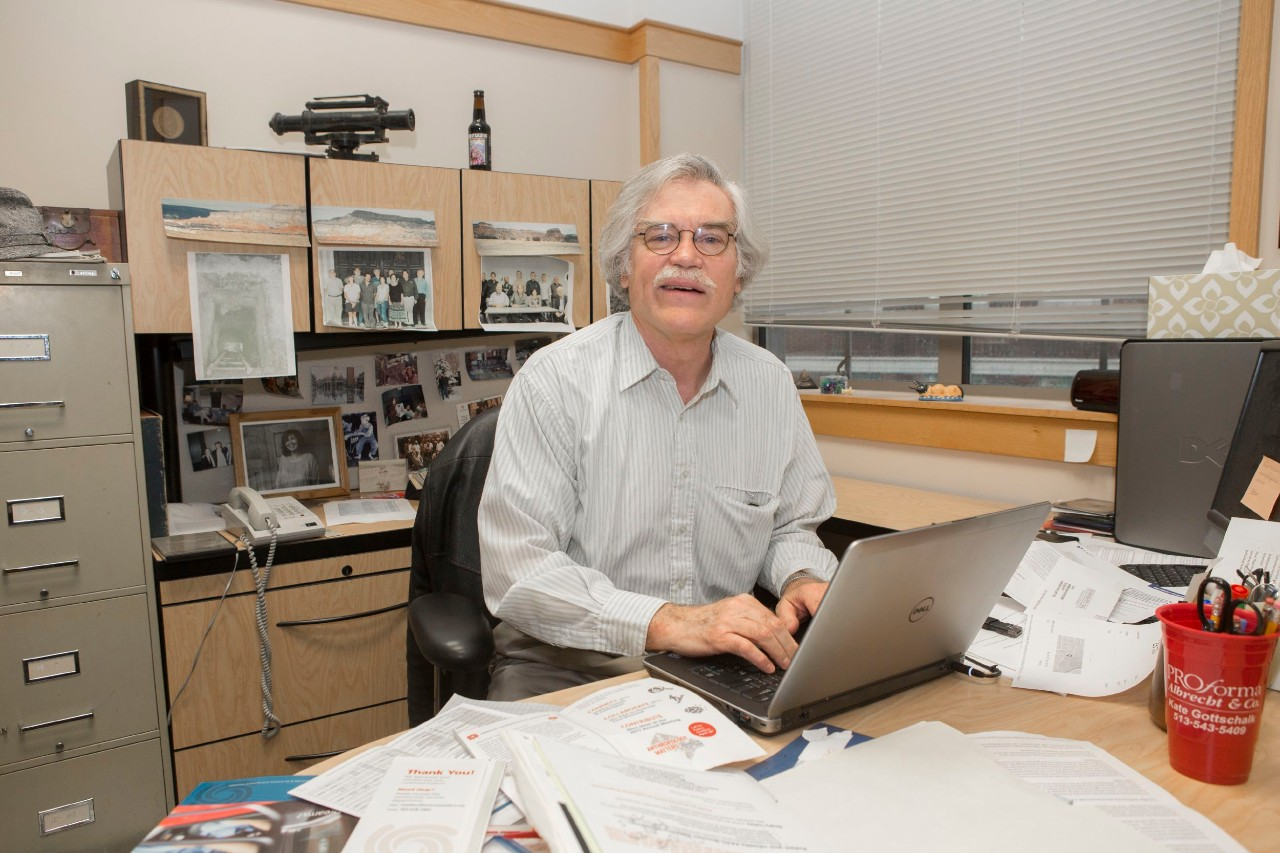Vernon Scarborough works at a laptop.