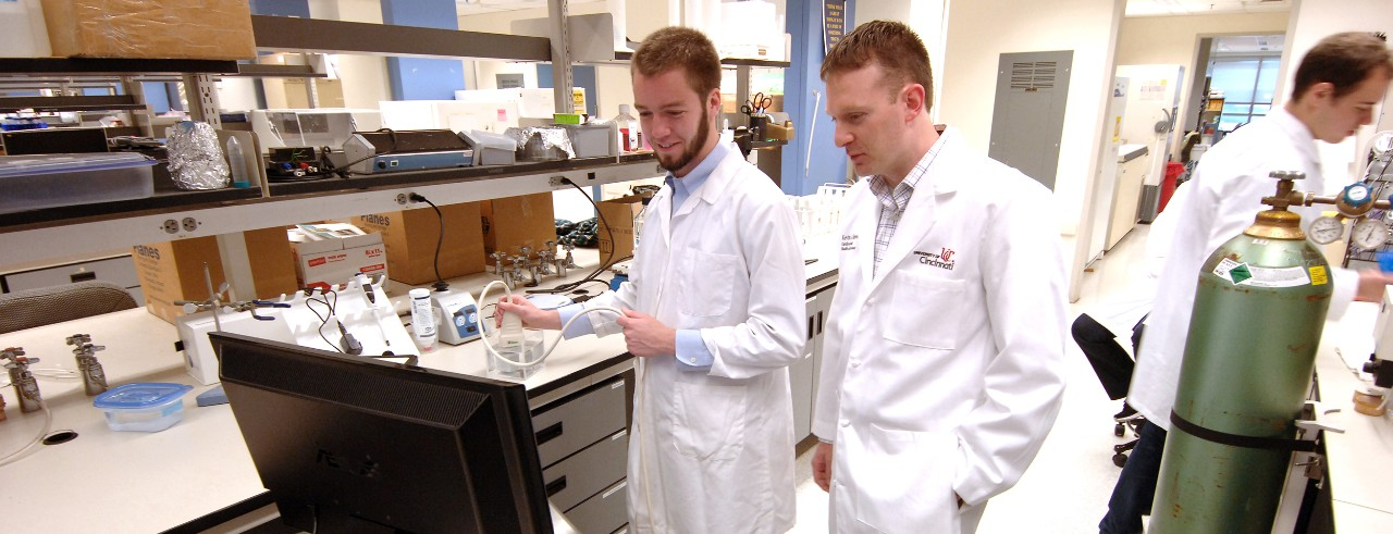 Kevin Haworth, PhD, shown with colleague in his laboratory