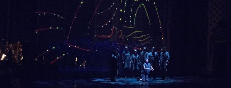 Singers on stage during a performance of L'enfant et les sortilèges