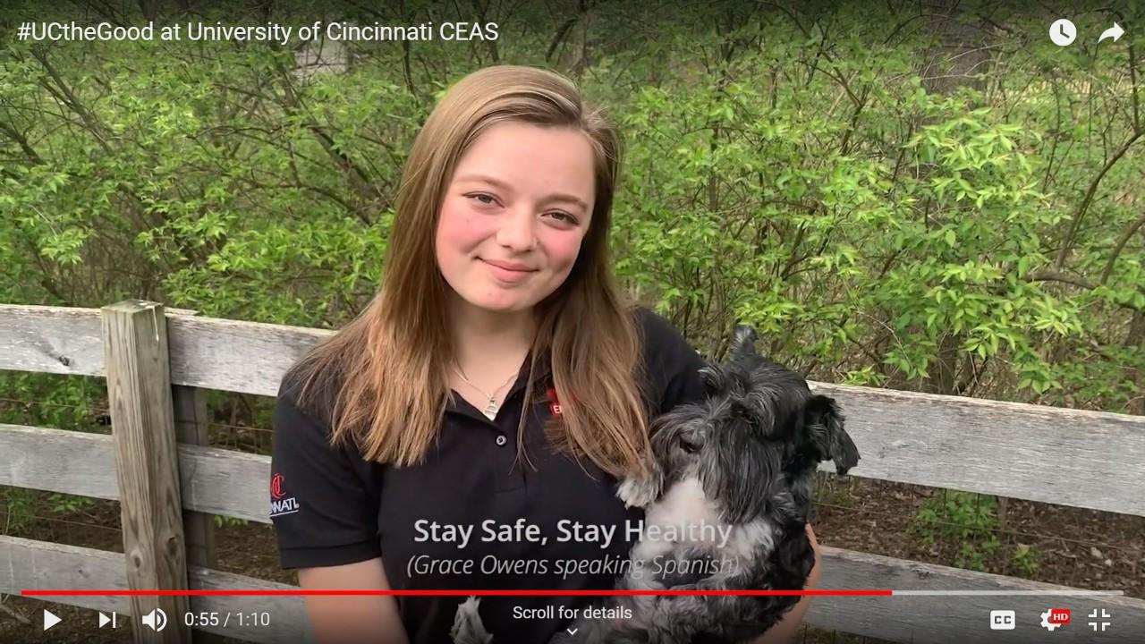UC student Grace Owens holder her dog