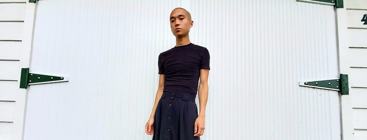 Eddy Kwon stands in front of a white door