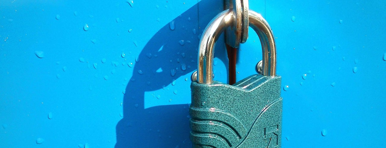 Green padlock on a blue object