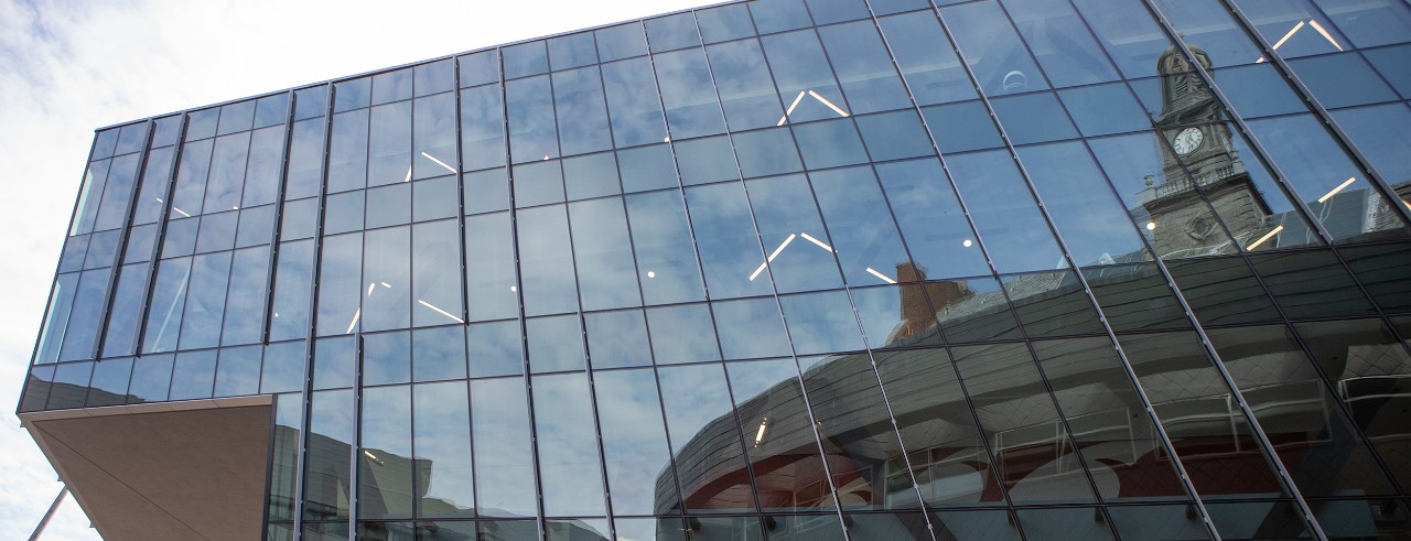Tangeman University Center mirrored in the glass exterior of a nearby building