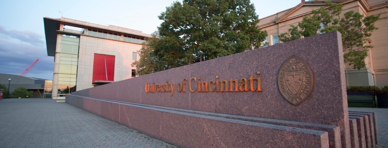 A fountain on campus has the University of Cincinnati name and seal.