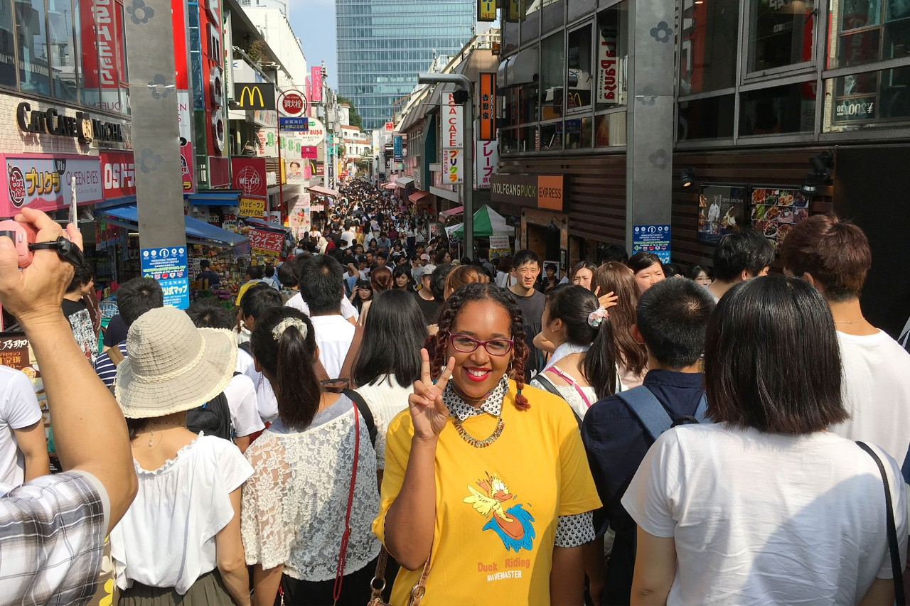 Kalea Lucas poses on a busy street in Seoul, South Korea.