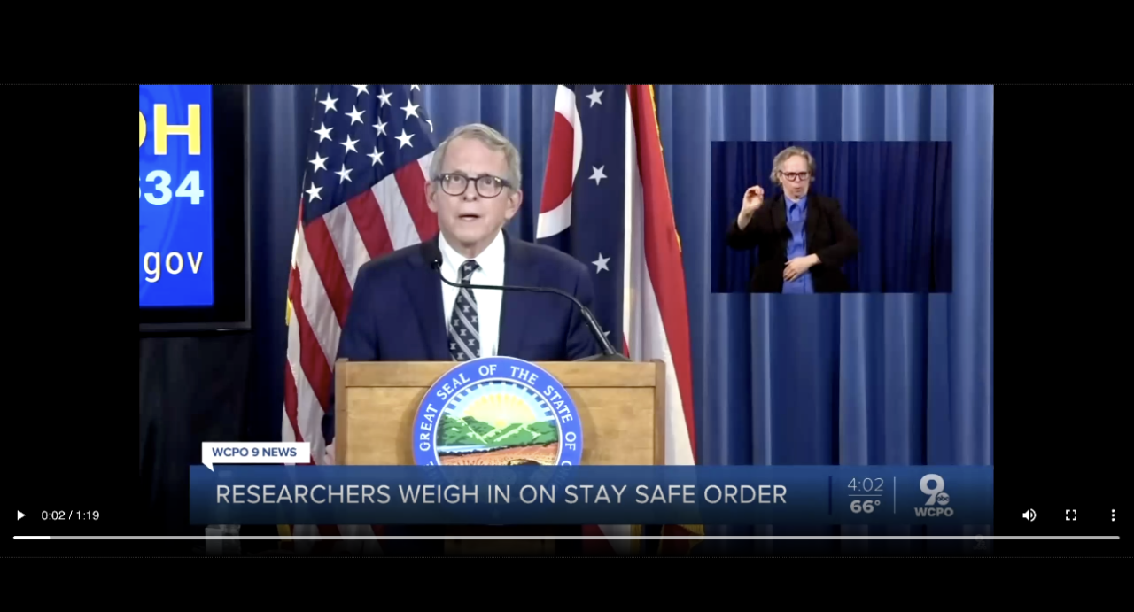 """A screenshot from WCPO shows Ohio Gov. Mike DeWine talking about COVID-19 with the banner """"Researchers weigh in on stay safe order."""""""
