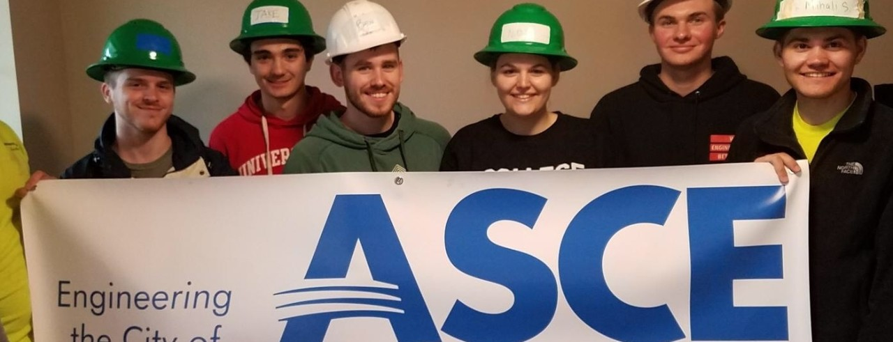 ASCE students hold a sign that says ASCE