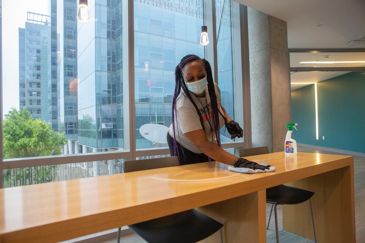 Custodian cleans table