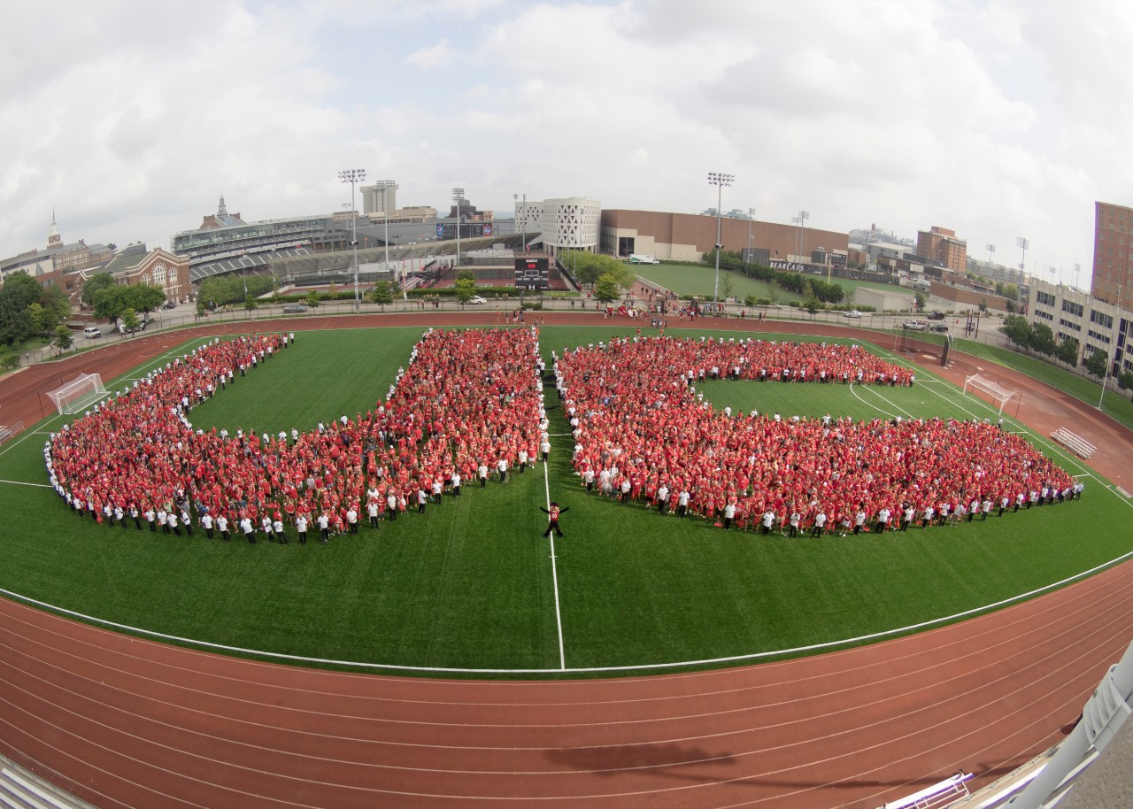 Spelling out UC on the running track