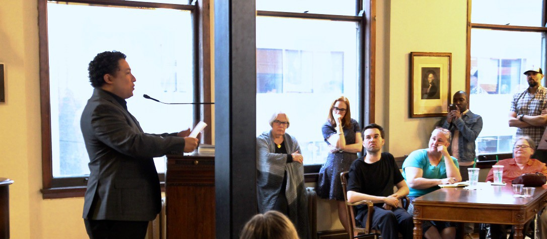 Manuel Iris gives a public reading.