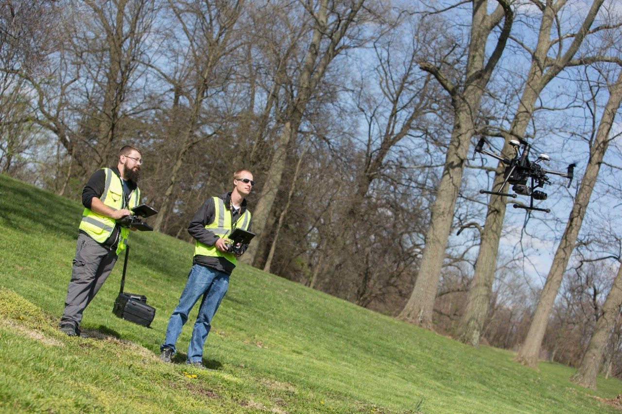 UC students operate a drone near campus.