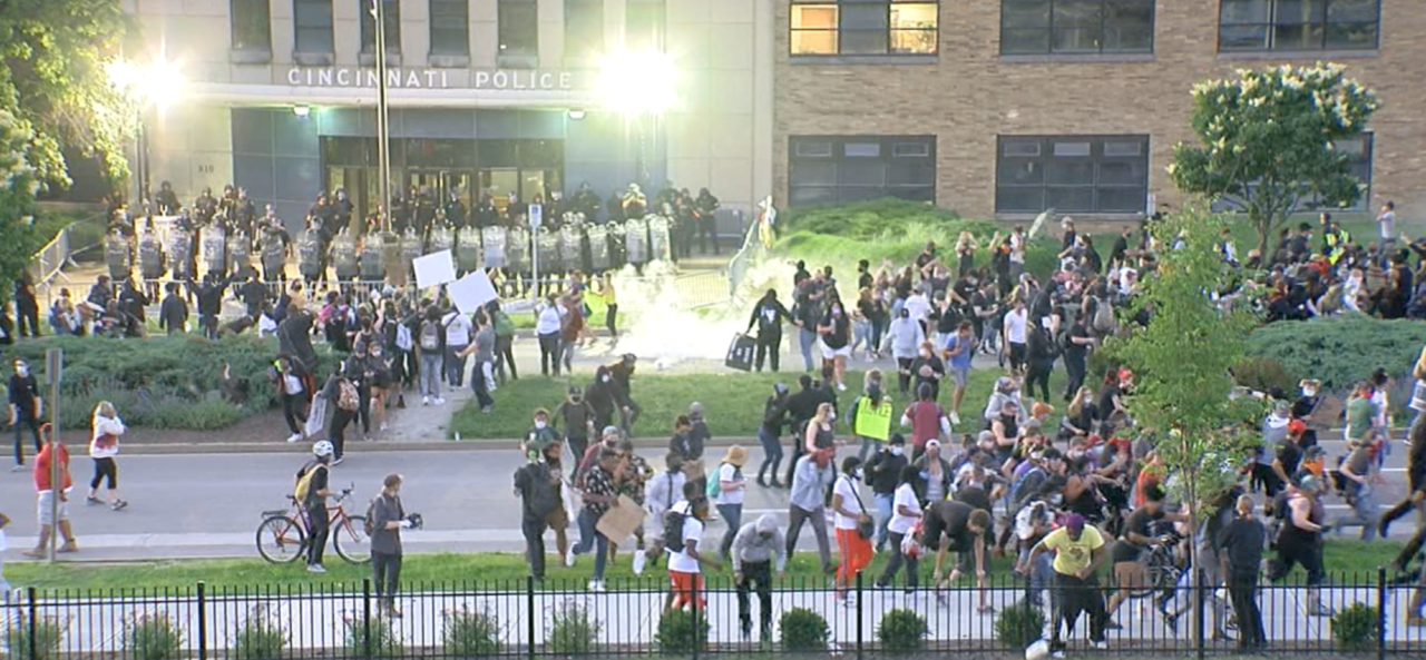 A large group of protesters outside of Cincinnati Police District One headquarters