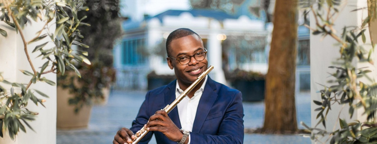 Flutist Demarre McGill poses with his instrument