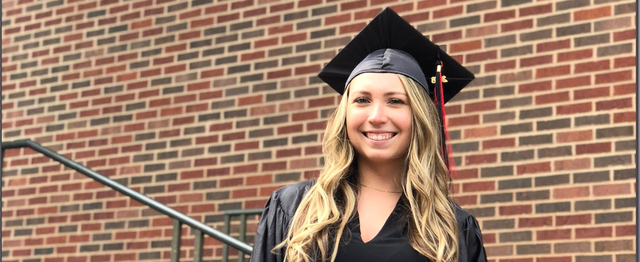 Sam Green wears her 2018 cap ad gown from UC.