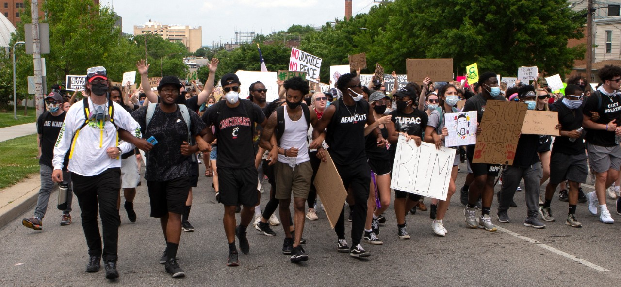 Large group of students protest in street