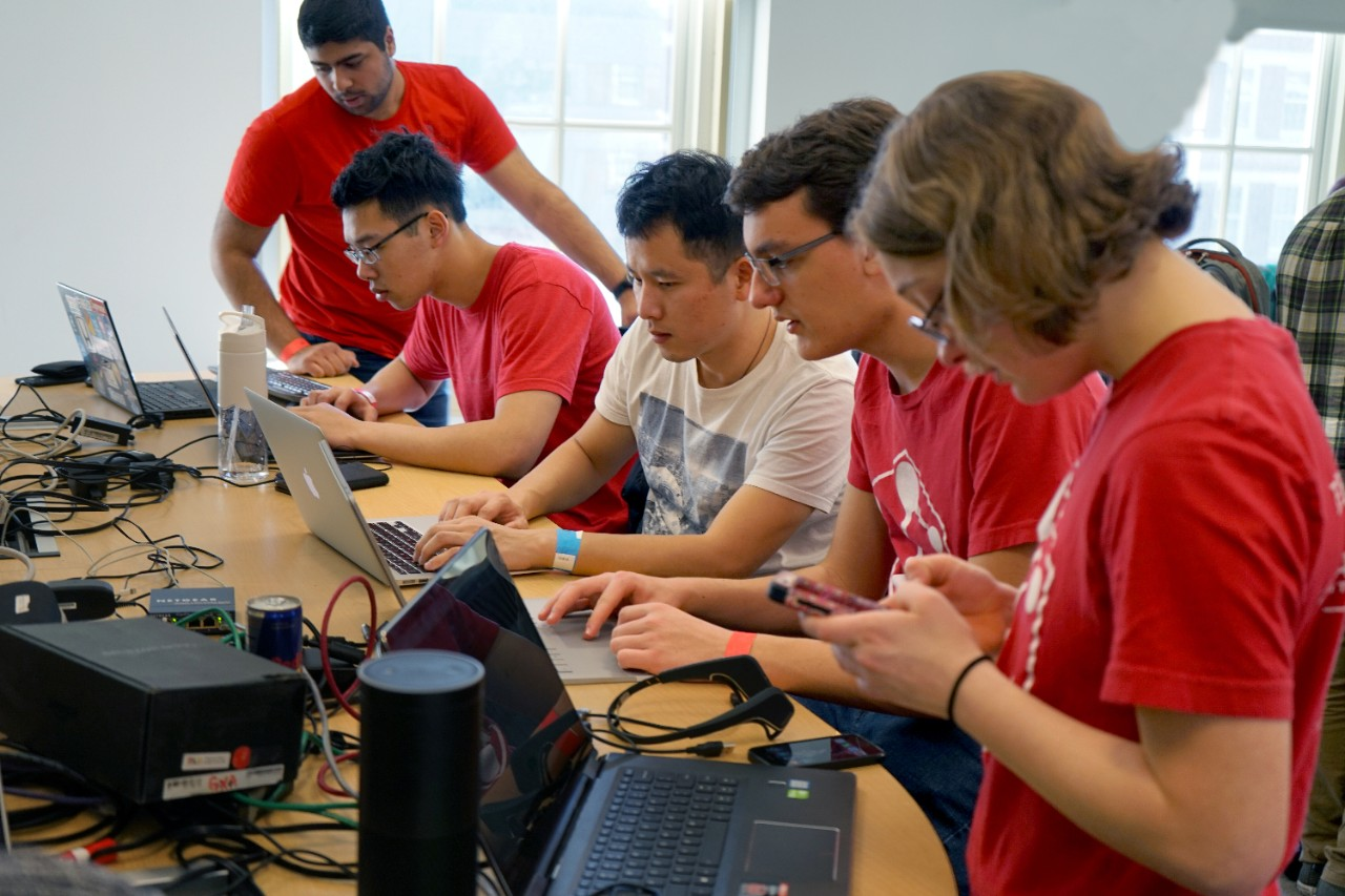 Group of students at hackathon event tinkering with technology
