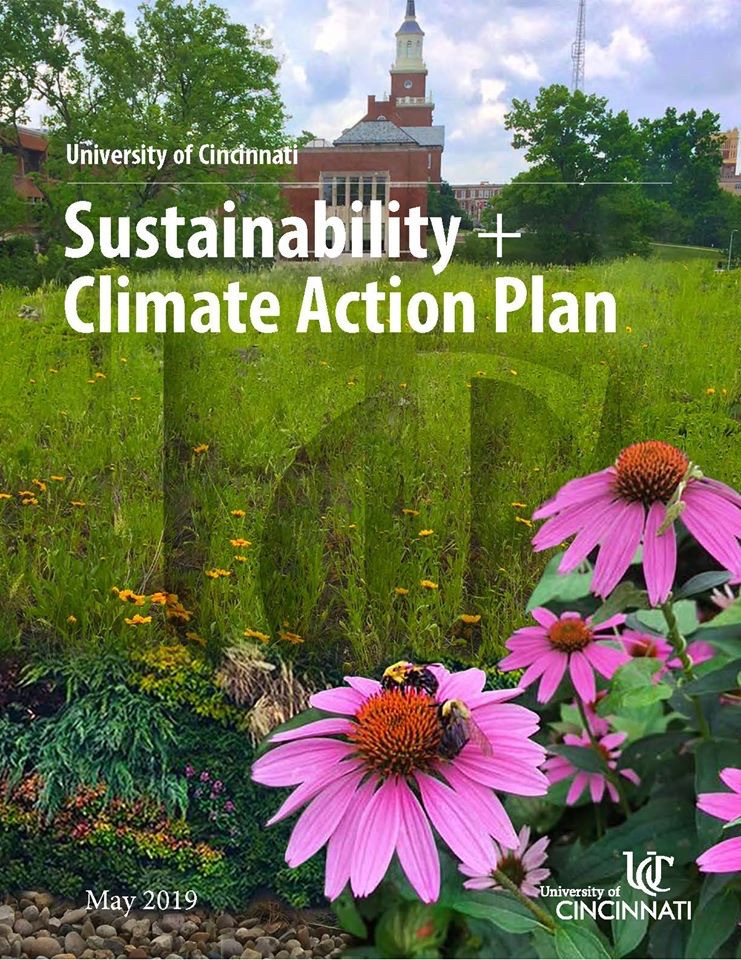 Front cover of UC's Sustainability and Climate Action Plan showing pink daisies in foreground with McMicken Hall in background.