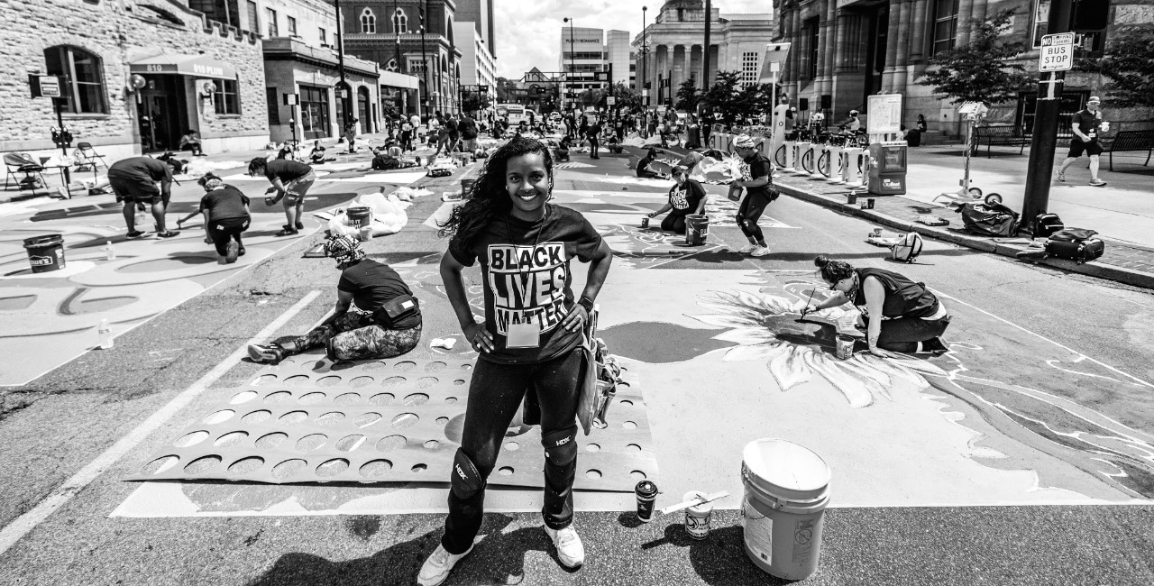 Adora Maxberry, a UC student helps with the Black Lives Matter mural in downtown Cincinnati.
