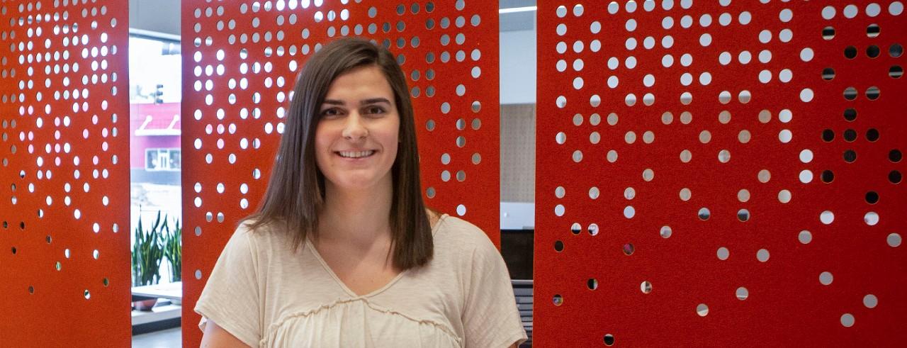 Abby McInturf portrait taken inside Venture Lab office at 1819 Innovation Hub