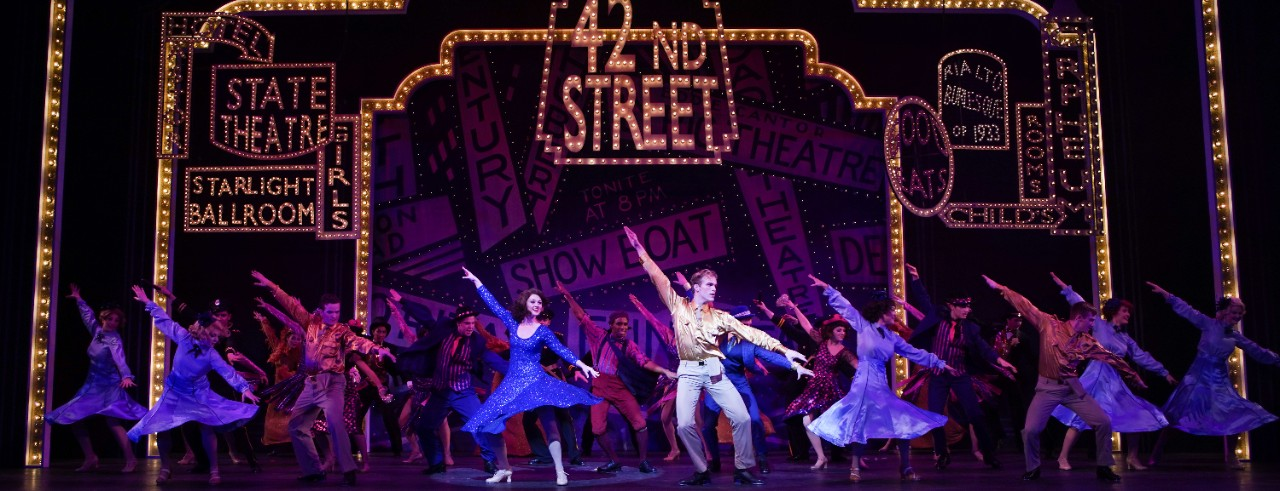 """Actors dance on stage during CCM's production of """"42nd Street"""""""
