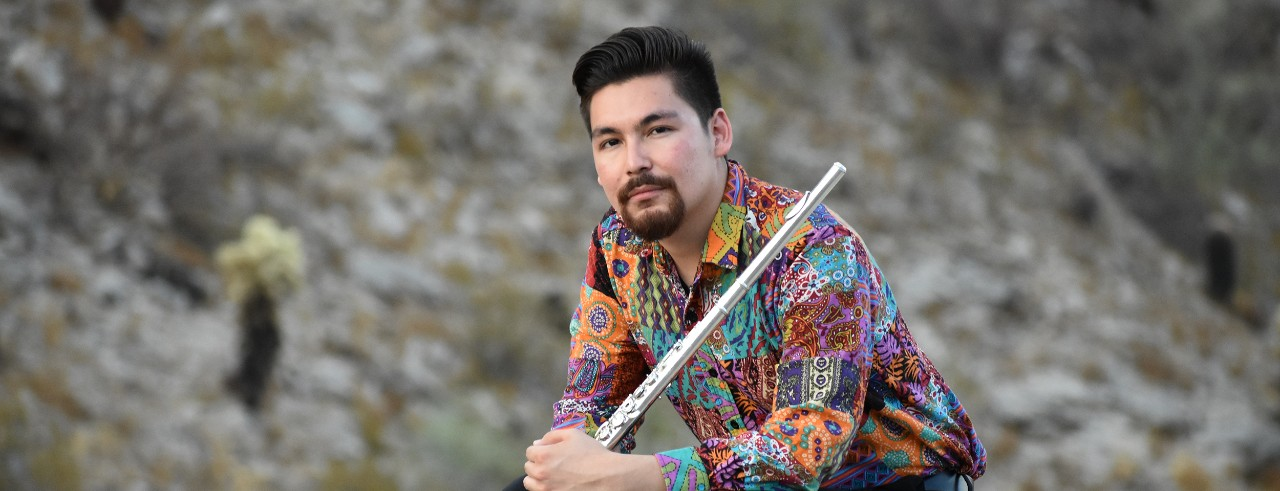 Chaz Salazar poses with his flute