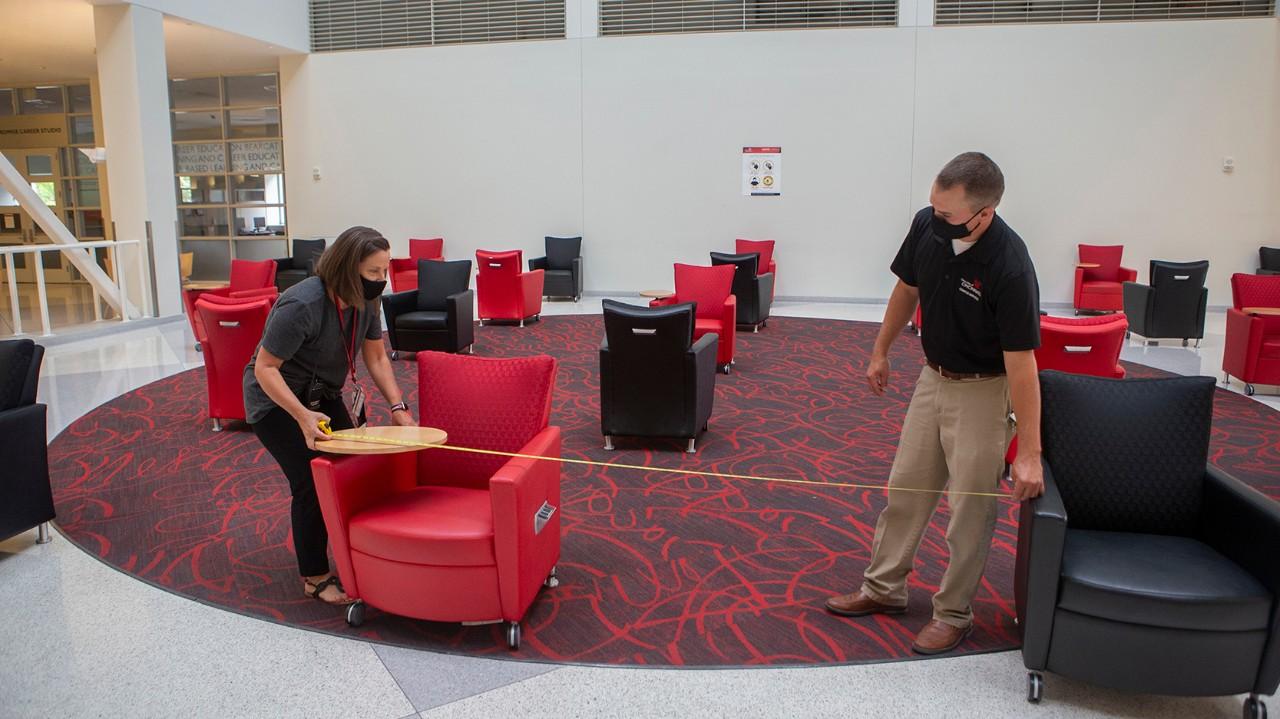 Staff arrange furniture in TUC lobby