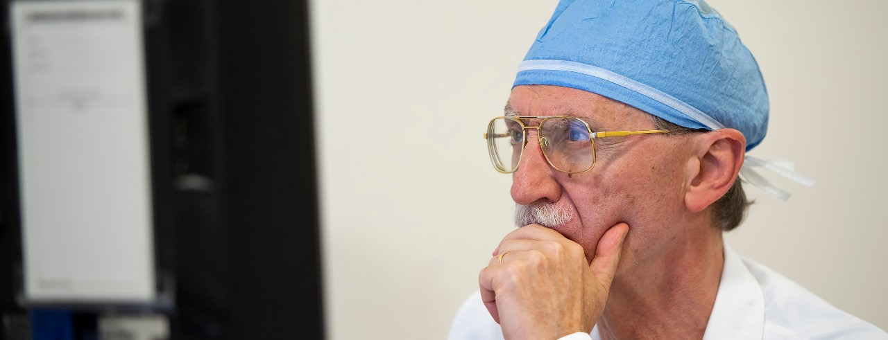 Dr. Mario Zuccarello looking at computer screen