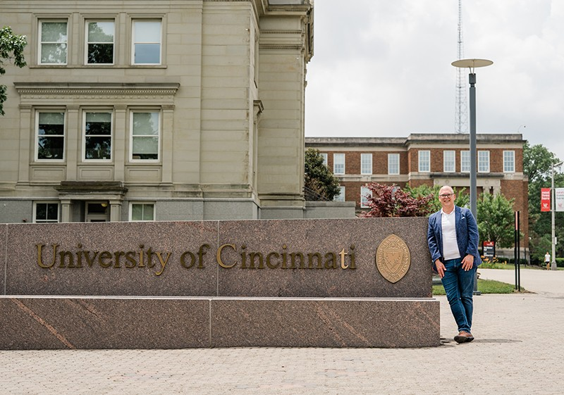 Jim Obergefell poses by UC sign on campus