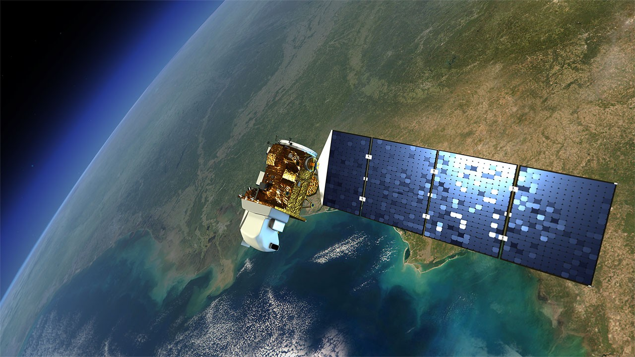 An artist's illustration of a Landsat satellite floating over the Pacific Ocean.