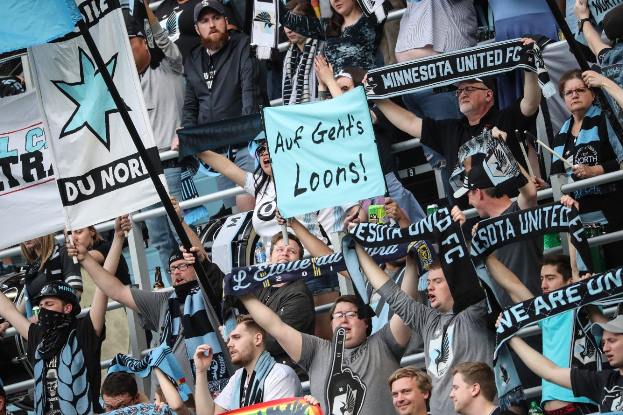 Fans cheering at a Minnesota United game