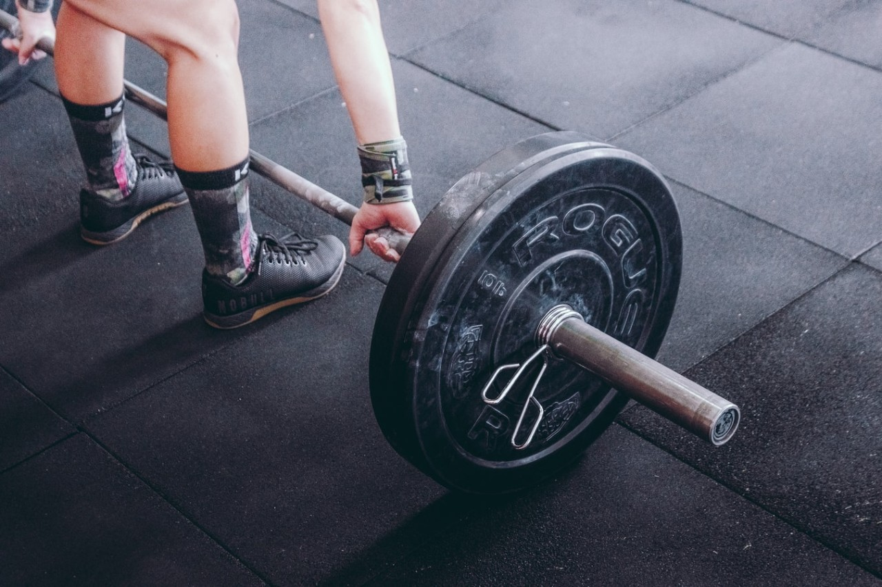 person lifting a weight