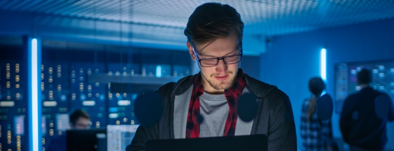 Young man working at desk in cybersecurity department