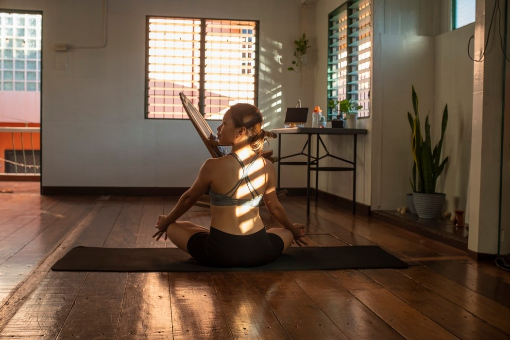 mindful pose by women practicing yoga