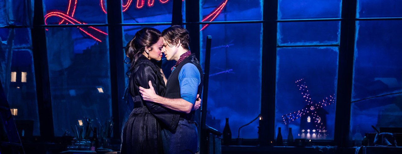Karen Olivo and Aaron Tveit on stage during a Moulin Rouge performance