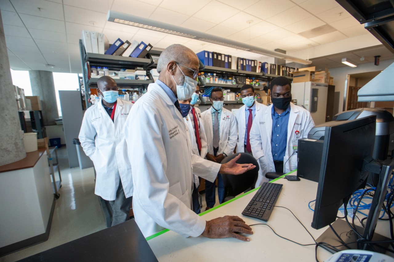Alvin Crawford, MD, shown in a UC College of Medicine lab with medical students residents.