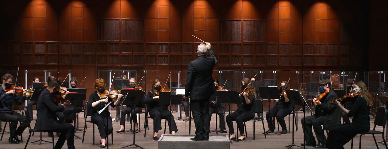 The CCM Philharmonia student orchestra performs on the stage of Corbett Auditorium.