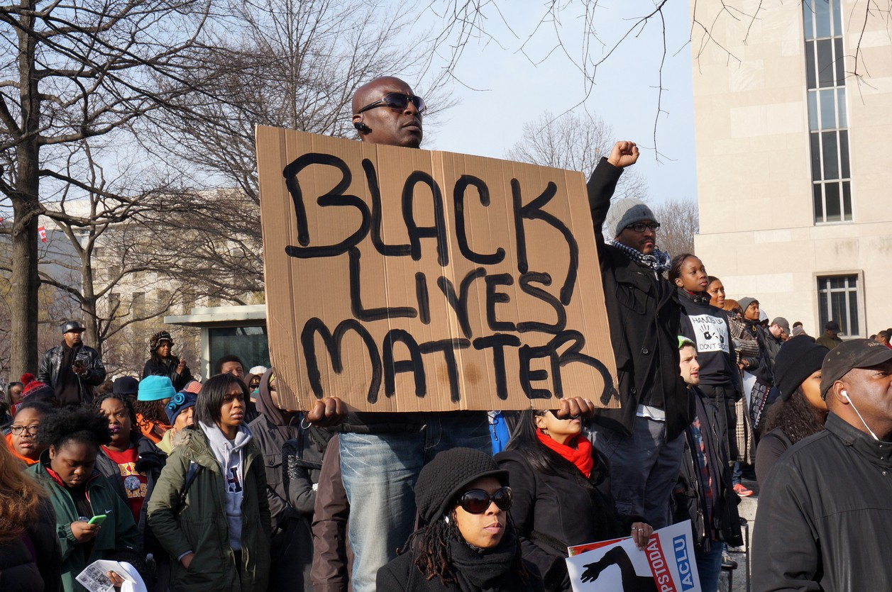 African American man holding up Black Lives Matter sign at protest