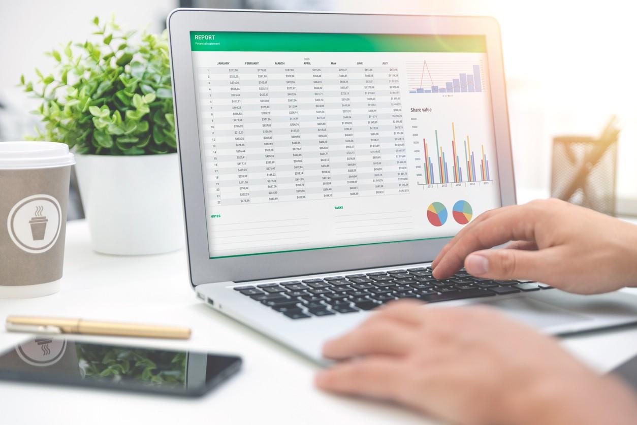 man analyzes data on computer screen
