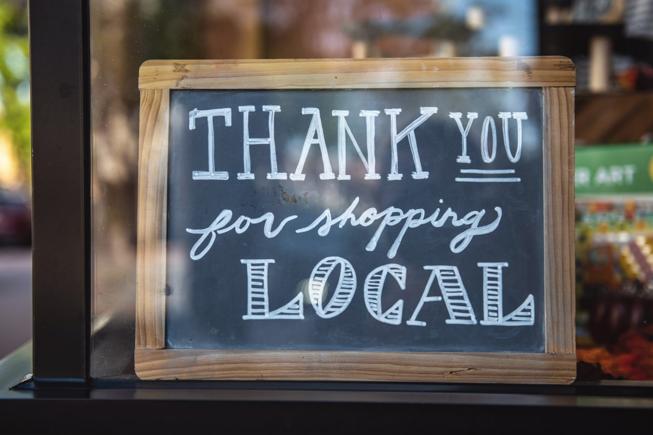 """A sign that reads """"Thank you for shopping local."""""""