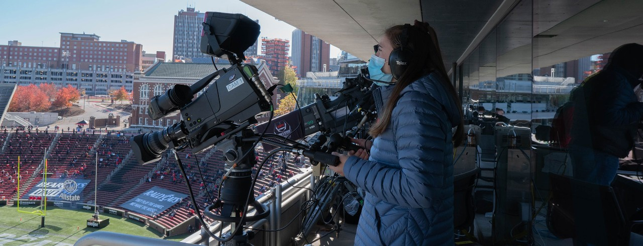 A student works on a ESPN+ sports broadcast in UC's Nippert stadium