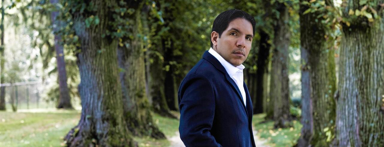 A headshot of Isaí Jess Muñoz