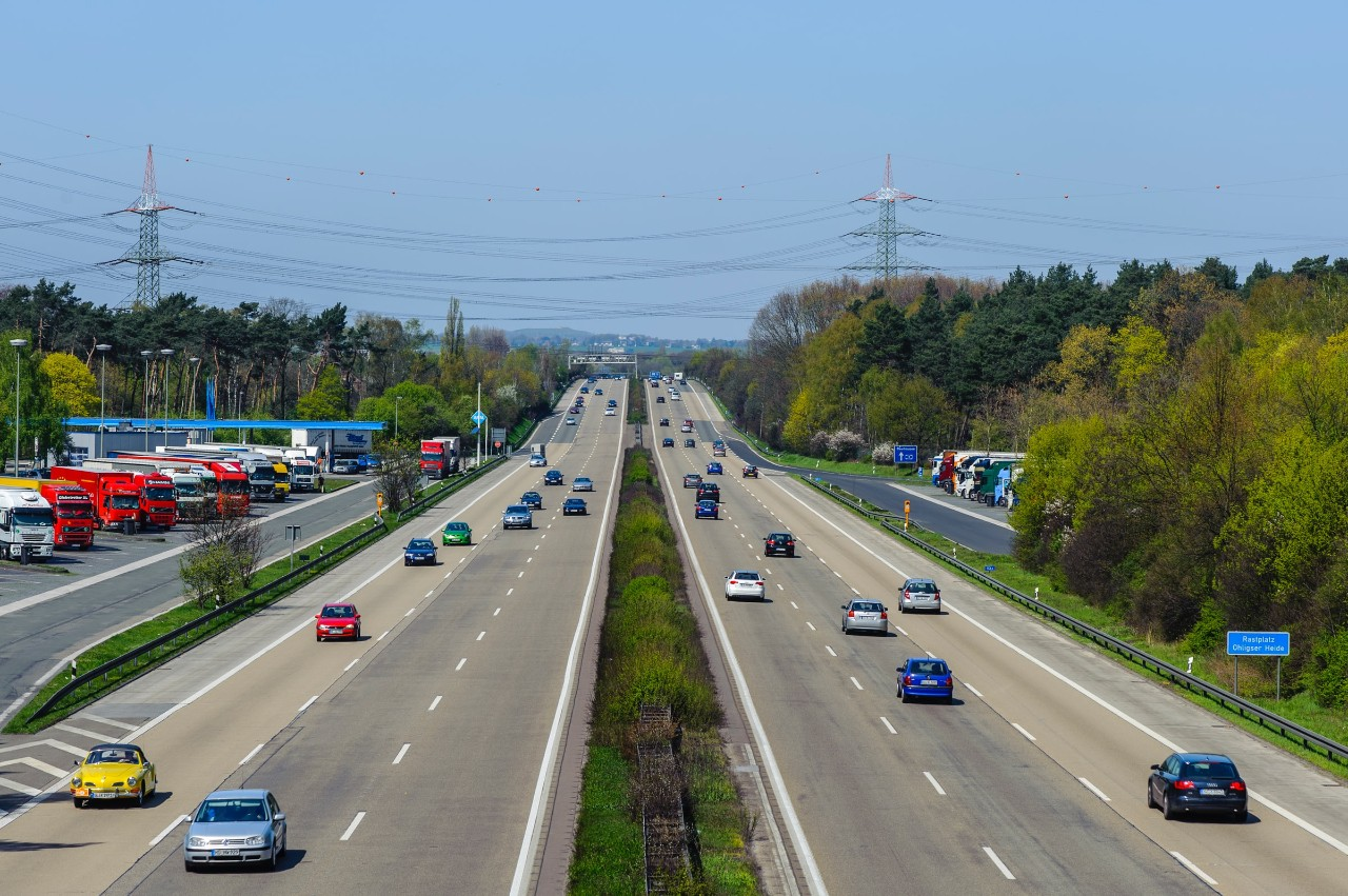 wide angle of cars in traffic on a highway